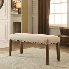 Beautifully inviting, this dining bench is a gorgeous display of rustic and modern elements. The ivory flax fabric adds brightness and warmth while edgy nailhead trim accentuates the rustic walnut finish.