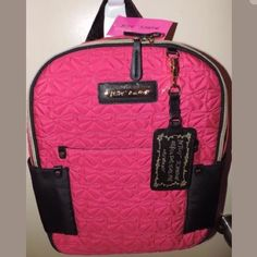"""NWT Betsey Johnson Fuchsia Quilted Bows Backpack Brand New With Tag Hot Pink Betsey Johnson Backpack ---  Zips Around the Top Front , Inside Zipper, 2 Inside Slots, Front pocket Measures 15""""x13""""x3.5"""" Black Backpack Straps, Quilted Puffy Bow Tie (design) MSRP $108 Zippers, Straps and luggage tag all have original plastic coverings and packaging. Betsey Johnson Bags Backpacks"""
