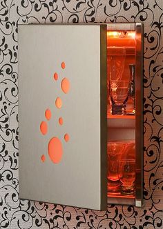 From Medicine Cabinet To Wall Bar using LED lighting.