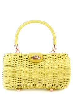 Wicker Baguette Purse in Pastel Yellow Vintage Inspired Baguette Wicker Purse by Pinup Couture Handbags. Handwoven from durable vinyl-coated rattan, our sturdy bags feature a beautiful faille fabric lining with open pocket, matching faux-leather closure tab and rose-gold metal details. This 'Baguette' style is the perfect size for toting around your everyday essentials! Made in the countryside of China by a family owned and operated facility that has been making wicker bags and wicker goods…
