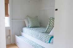 Trundle bed in guest bedroom of beach house by allee architecture + design, llc