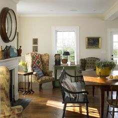 Wing chairs and an early 19-th century painted sette give this room an early American antique feeling.