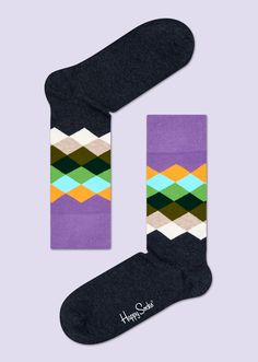 If variety is the spice of life, it doesn't get any better than this pair of faded diamond socks. These graphic socks have diamonds of varying colors for detailed style. From purple to yellow to green to white, dark gray crew socks make it easy to stand out. Because they're crafted with high-quality combed cotton, the detail on these socks is woven with precision. Made for men and women, everyone will appreciate the timeless design of faded diamonds.