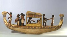 Miniature Wooden Boat Model with Black Africans inside, Egypt. Egyptians had great craftsmanship