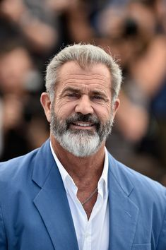 """Mel Gibson Photos - Mel Gibson attends the """"Blood Father"""" Photocall at the annual Cannes Film Festival at Palais des Festivals on May 2016 in Cannes, France. - 'Blood Father' - Photocall - The Annual Cannes Film Festival Silver Hair Men, Men With Grey Hair, Gray Hair, Beard Styles For Men, Hair And Beard Styles, Hair Styles, Barba Van Dyke, Trendy Mens Haircuts, World Hair"""