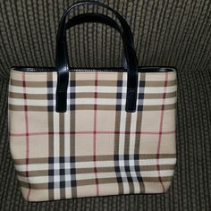 Burberry Nova Check Mini Tote Really cute mini tote with dust bag.  Kept in dust bag hardly used.  Small spot on one side of bag Burberry Bags Mini Bags