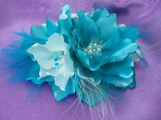 The flower clip been carefully hand crafted by Russian designer. Made for all hair types. Can be worn to weddings, graduations, upscale