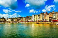 Our colorful world : Honfleur, France  Well known for its picturesque port, Honfleur's distinctive slate fronted houses are more famous. Many of them have been painted by famous artists: think Monet, Courbet and Boudin. Let Honfleur give you a warm welcome, and explore the delights of this lovely city for yourself. barretttravel.globaltravel.com pamelabarrett22@gmail.com