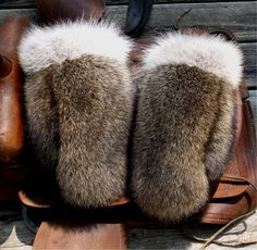 Raccoon fur mittens with coyote trim and red fleece by CalfDr
