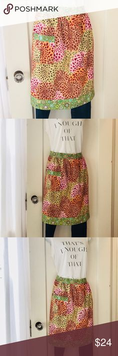 Colorful Floral Apron Colorful Floral Apron with cute contrasting patterns.  Ties in the back.  22 inches long Other