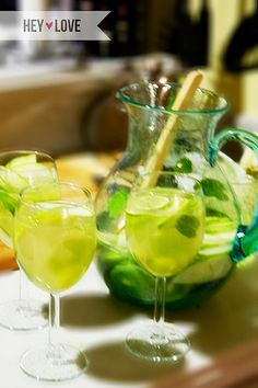 St. Patricks Green sangria. White wine, lemon lime soda, and a variety of sliced fresh fruit including limes, kiwi, grapes and apples. Fresh mint completes this bubbly St. Patrick's Day drink.