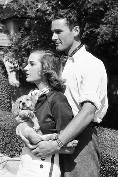 Errol Flynn and his first wife, Lili Damita pose for the camera