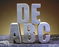 This is a full set of the 26 (cement) letters of the alphabet. These make a great toy to learn the alphabet with out in the yard, or arrange them on a shelf for a whimsical touch. There is one set pic Cement, Concrete, Slumped Glass, Learning The Alphabet, Coin Jewelry, Garden Toys, Glass Etching, Numerology, Wall Tiles