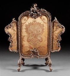 <b>Louis XV style carved giltwood tapestry upholstered tripartite fire screen</b> <br  /> second half-19th century; 46 in., 39 in. W.