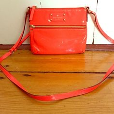 Kate Spade Neon Orange Patent Leather CrossBody Very gently used Kate Spade neon orange patent leather crossbody bag. kate spade Bags Crossbody Bags