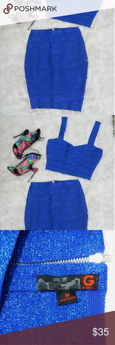 """G by Guess Cobalt Joelle Bandage Set Beautiful metallic blue bandage set. Removed the tags but never got around to wearing before getting pregnant with twins.  Measurements Skirt: Waist 13.5"""" laying flat 14"""" stretched Skirt widens at thighs 17.5"""" flat 18"""" stretched Length 20.5"""" flat 21"""" stretched  Top:  Pit to pit 15.5"""" flat 16"""" stretched Hemline 12.5"""" flat 13"""" stretched Shoulder to hem 14.5"""" flat 15"""" stretched Guess Dresses Mini"""
