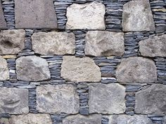 Dry stacked stone retaining wall in a park in Garachico town centre, Canary Islands