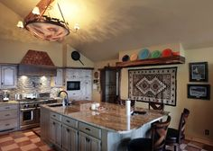 Clearing the Kitchen of Unnecessary Clutter:  Simplicity and minimization are key in the kitchen, says Monika MacIntyre, owner of Checkmark Concierge. MICHAEL WYKE / Tulsa World