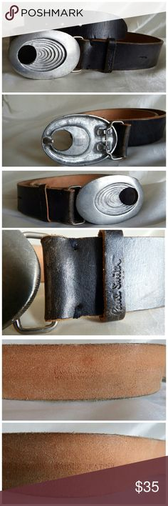 """Paul Smith - Rugged Bridle Leather Belt Hard to find rugged belt in thick supple, durable bridle leather. Chunky buckle (might be pewter) has multi-level swirl design on the face & coin-like ribbing on the sides.  Pre-loved but will last for generations! Belt is 47"""" / buckle is 3 1/2"""" x 2 1/4"""".  Made in England Paul Smith Accessories Belts"""