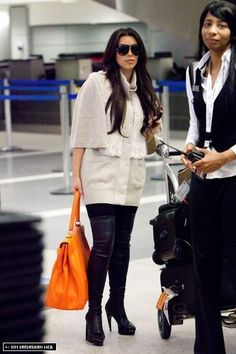 Kim is photographed at Heathrow airport then at LAX returning to LA 9/23/10 - kim-kardashian Photo