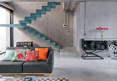 Philip-Scroback-reinforced-concrete-house-teal-colored-concrete-stairs