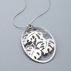 After drawing the image of a monstera tropical plant, this pendant is then peirced entirely by hand, shaped and polished. Materials: sterling silve...