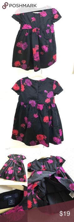 Baby Gap Black Floral Print Dress with Ruffle Flap Baby Gap size 3T black dress with red, pink and purple floral design. Babydoll waist and cascading ruffle flap detail. Slight princess seamed sleeves. 3 button closure on back. Fully lined. 100% cotton. Worn once for a preschool holiday performance. In excellent condition. Comes from a smoke-free home. GAP Dresses Casual