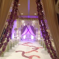 I like the drapes of the bridal gate here--I'd like it to be set up so that the audience can't see the bridal party or anyone coming in until after they cross that gate.  ALso like the floral design on the aisle, but with silk rather than fresh floral.