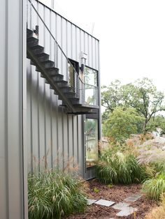 Welded stairs, corrugated metal, cable railing, grasses, glass, roof deck