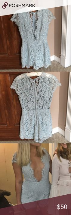 NBD lace romper Stunning sea foam colored lace romper! This romper has only been worn once. A plunging neckline and overall faltering silhouette. Size 4. NBD Pants Jumpsuits & Rompers