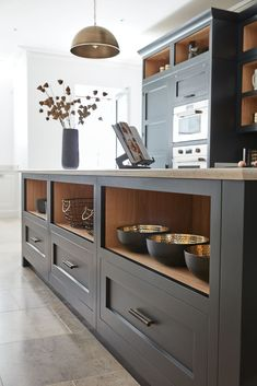 Dark Grey Shaker Style Kitchen The use of open shelving on the walls and inside the island gives numerous storage options as well as a place to display prized pieces. Shaker Style Kitchens, Grey Kitchens, Cool Kitchens, Shaker Style Cabinets, Custom Kitchens, Kitchen Paint, New Kitchen, Kitchen Decor, Kitchen Grey