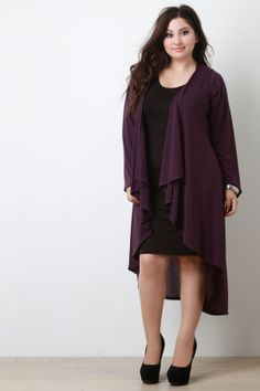 Longline Drape Open Front Cardigan. Description This longline  plus size cardigan  features a stretchy knit fabrication, open front with drape detail, long sleeves design, and finished with asymmetrical curved hemline. Accessories sold separately. Made in U.S.A. 87% Polyester, 10% Rayon, 3% Spandex.  Measurement   Size Bust Waist Hip Length Sleeve   1X 21 23  28  45  23    2X 22  24  29  46  24    3X 23  25  30  47  25