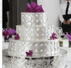 The Cake  Jacalyn and Rio's red velvet wedding cake with cream cheese frosting was a three-tier confection covered with large silver polka dots and accented with bright pink orchids.