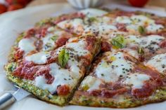 Zucchini-Crusted Pizza with Easy Homemade Tomato Sauce is yummy! Try making a delicious zucchini crust with this recipe.  #lowcarbrecipes #zucchinicrust #healthypizza