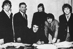 Pink Floyd signing their record contract, February 1967.