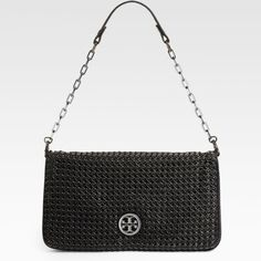 """TORY BURCH metal eyelet reva clutch Original Tory Burch Black Reva Metal Eyelet Clutch/Shoulder bagGorgeous washed leather dotted with metal eyelets and adored with tonal logo medallion, features a removable leather and chain strap for more wear options. Leather and chain strap, 11 """" dropMagnetic flap closureTwo inside zipper pockets with canvas lining. Great condition. Worn 4x. Tory Burch Bags Clutches & Wristlets"""