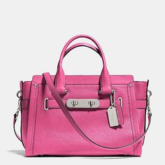 I love my Black one now PINK! must have Coach Swagger in Pebble Leather
