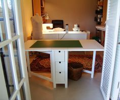 This dining table from Ikea would make a great fabric cutting and supply storage area.