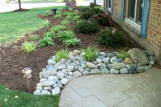 Using river rock to transition between our new stone patio and the planting bed might work better than just going right to mulch. Stone Landscaping, Landscaping With Rocks, Modern Landscaping, Outdoor Landscaping, Outdoor Gardens, Landscaping Ideas, Backyard Ideas, Garden Structures, Garden Paths