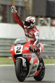 Luca Cadalora of Italy celebrates on his Yamaha after winning the 500cc class of the Brazilian Grand Prix at the Autodromo Nelson Piquet circuit in Rio de Janeiro, Brazil. \ Mandatory Credit: Mike Cooper/Allsport