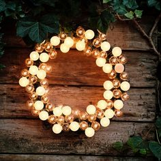 Electric wreath with globe lights frosted with paint and attached with zip ties. Christmas Wreaths With Lights, Lighted Wreaths, Xmas Lights, Outdoor Christmas Decorations, Globe Lights, Holiday Lights, Christmas Diy, Door Wreaths, Christmas Greenery