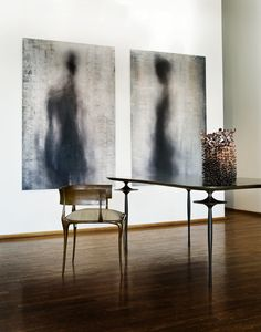 Modern dining room w/ abstract paintings