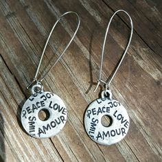 Amour fashion earrings .999 silver pierced earrings with the words peace, amour, love, smile and joy on both sides of the earrings. Nwot never worn. (More pure than silver and will take longer to tarnish!)  Please look closely as the earrings as what you see is what you get. Artisan made may have some slight imperfections but won't take away from the beauty of the earrings.   Will be wrapped in a box and mailed in a bubble mailer to ensure safety. Please ask any and all questions before…
