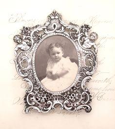 Antique Victorian STERLING SILVER FRAME 1895 Sheffield Uk Samuel Boyce Landeck Putti Cherub Laden Picture Frame Baby Picture by Pizzapusshorse on Etsy https://www.etsy.com/listing/249372907/antique-victorian-sterling-silver-frame