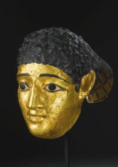 An Egyptian Polychrome and Gilt Plaster Mummy Mask of a Man, Roman Period, circa 1st Century A.D.