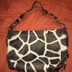 Animal print purse Animal print purse, with shiny red accents. Pic 4 shows a slight amount of dirt- the rest is wear and tear free. Bags Mini Bags
