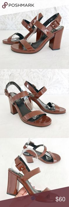 Espace Robert Clergerie brown patent sandals On trend! Rust-brown patent leather platform sandals. Cool diagonal strap across vamp. Chunky covered heel, small covered platform. Leather sole. One of my favorite luxury brands--bold style, excellent quality. Gently loved. I've worn these a few times--I'd say these are in very good used condition. One small flaw on the back of the right heel (see pic #5); it's actually more noticeable in this photo than in real life. (I bumped the contrast so…