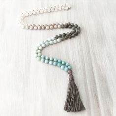 I am in love with this 108 bead mala. The aqua green ombre reminds me of the enchanting grace of a mermaids tail. Its even more beautiful in person. Hand-knotted with love and gorgeous natural gemstones, these prayer beads will surely serve as a stunning companion in your day to day life. See below for stone healing properties. · · · J e w e l r y . I n f o · · · Materials: + 8mm Amazonite + 8mm Labradorite + 8mm White Lace Agate + 8mm White Faceted Agate + 8mm Snow Quartz + Guru Bead…