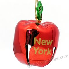 Metal Apple Bell New York Christmas Ornament A bright and unique bell ornament for your Christmas tree. (http://www.nycwebstore.com/new-york-apple-bell-ornament/)