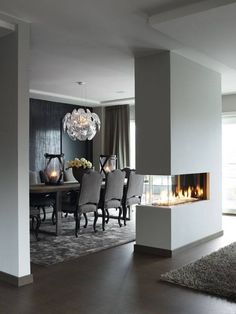This is a very modern, stylish heating solution. It leaves large rooms spacious, while separating the two spaces at the same time. This fire place is obviously double sided as well, providing heat from both ends.